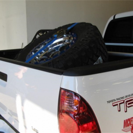 N-Fab Bed Mounted Tire Carrier Universal - Gloss Black - Blue Strap BM1TCBL