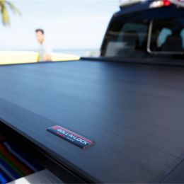 Roll-N-Lock 05-15 Toyota Tacoma Double Cab 59-1/2in E-Series Retractable Tonneau Cover RC507E