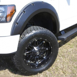 Lund 16-17 Nissan Titan XD RX-Rivet Style Smooth Elite Series Fender Flares - Black (4 Pc.) RX120S